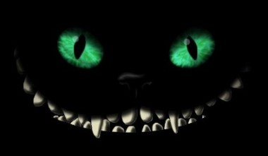 Scary cat eyes and teeth on black background
